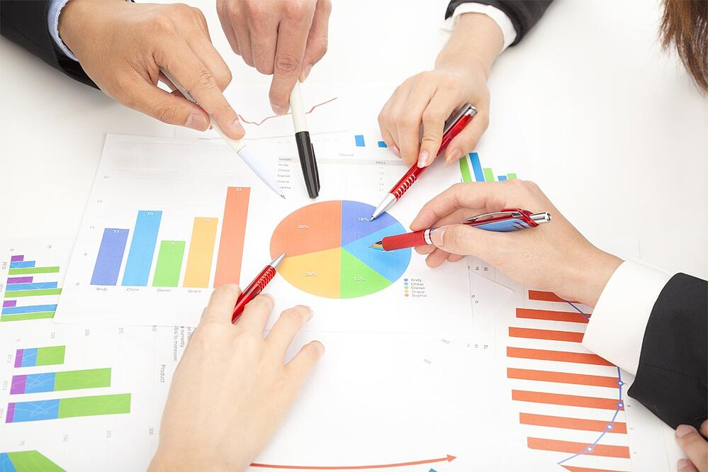 Image of Business People Reviewing Data