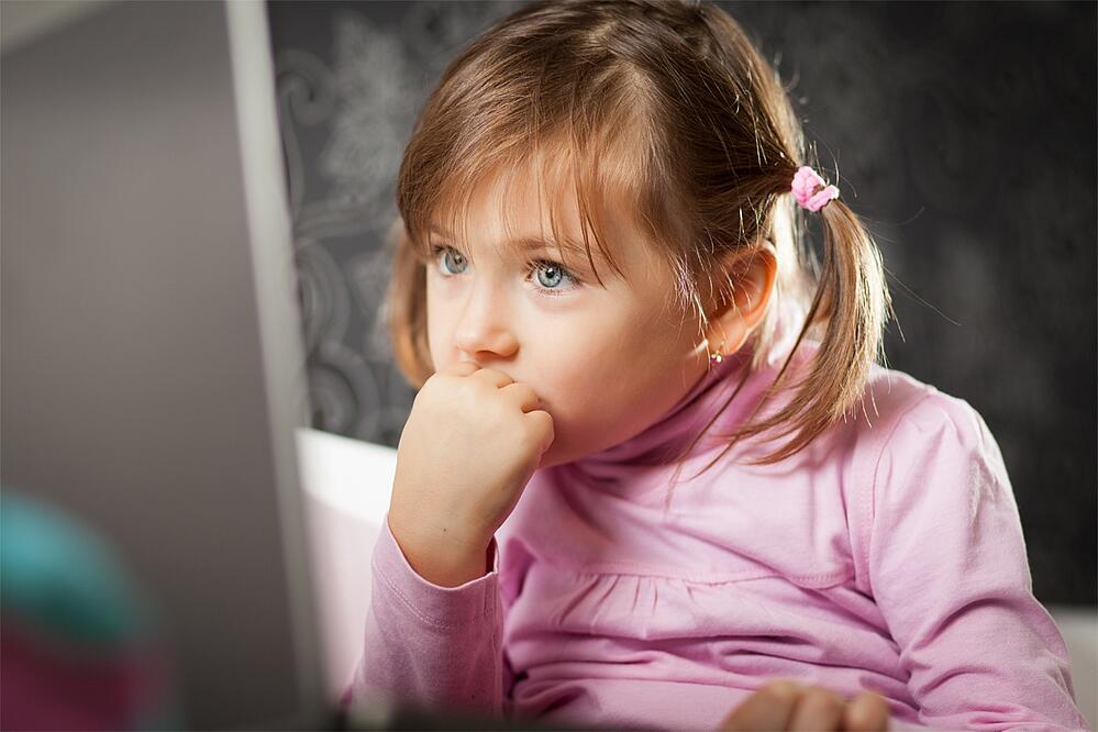 child totally engaged with a website