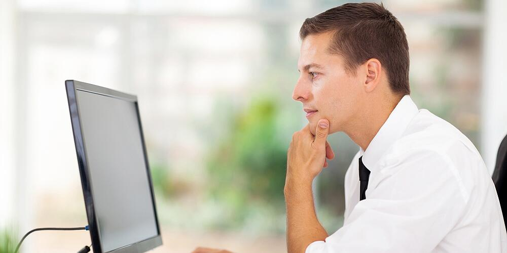 Business Owner Reading Google Analytics Report